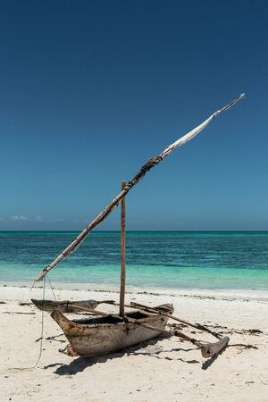 Traditional african dhow boat on amazing beach of Zanzibar at azur Indian Ocean