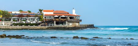 Panorama of stone headland with buildings over beautiful, blue ocean on Sal island, Cabo Verde, Cape Verde