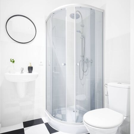 New design bathroom with shower and toilet and chess flooring
