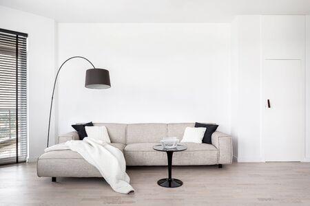 Living room with big corner sofa and black modern coffee table