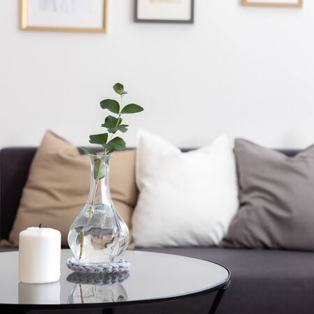 Simple living room with round side table and decorative pillows on the sofa 스톡 콘텐츠