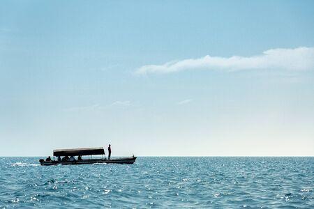 One tourist boat on calm blue water of Indian Ocean Reklamní fotografie