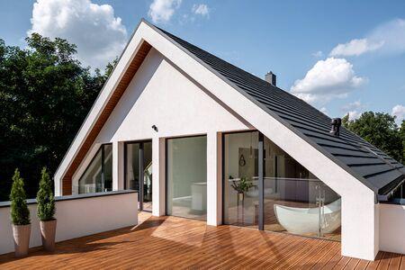 Elegant wooden home terrace with balcony doors from bathroom and bedroom Stock fotó