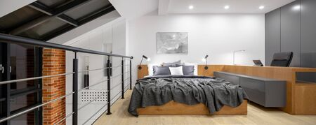 Panorama of mezzanine with bedroom and home office in loft style apartment