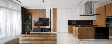 Panorama of luxury designed kitchen and living room, with marble tiles and hardwood parquet floor