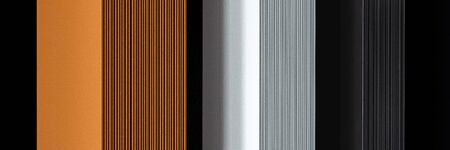 Panorama of designed and stylish wall radiators in black, white and copper