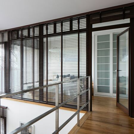 View from corridor in two-floor apartment on bedroom with window walls
