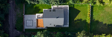 Panorama of elegant house exterior with nice green lawn garden, drone view