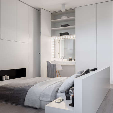 Luxury white bedroom with big bed and stylish dressing table in wardrobe with light bulbs turned on around mirror