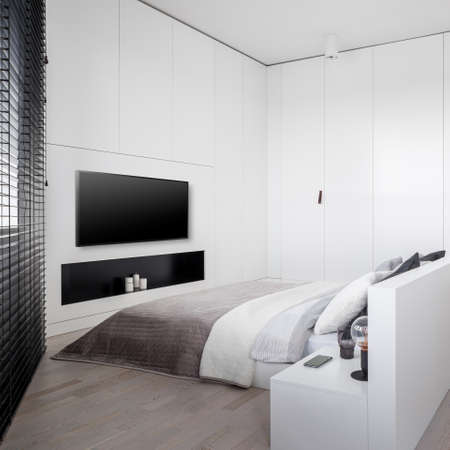 Luxury white bedroom with big bed, many wardrobes and lockers, window with black blinds and big television screen Imagens