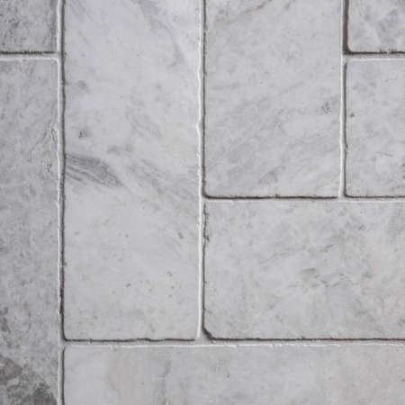 Close-up on stone, rectangle, gray colored floor tiles in herringbone like pattern Imagens