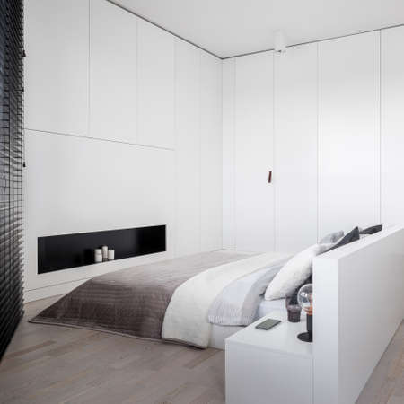 Luxury white bedroom with big, double bed, wooden floor and big window with black blinds