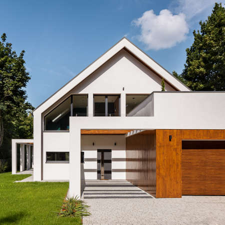 Beautiful and modern, white house with wooden panels on garage, exterior view