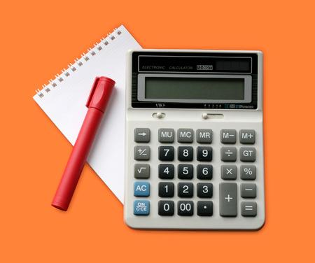 addition symbol: Calculator, marker and note on orange background Stock Photo