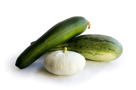 Marrow and zucchini on white background