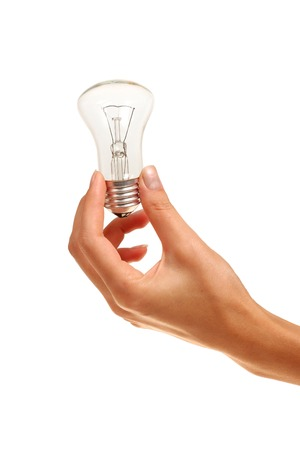 Bulb in woman`s hand on white background