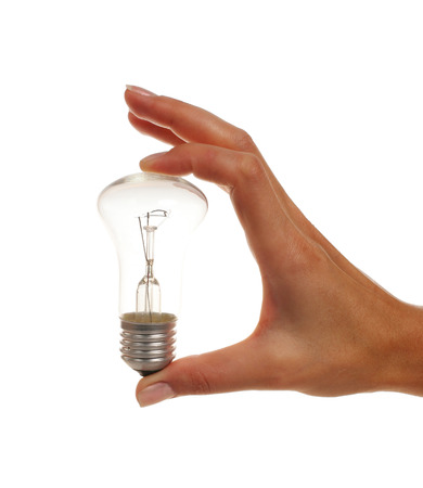 resistence: Bulb in woman`s hand on white background