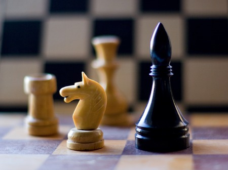 boardgames: Black and white chess figure on board