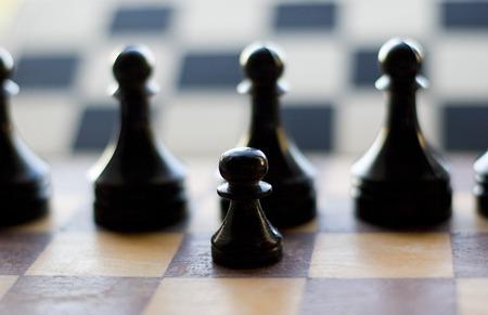 boardgames: Black pawn on chessboard