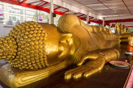 reclining: Reclining Buddha gold statue