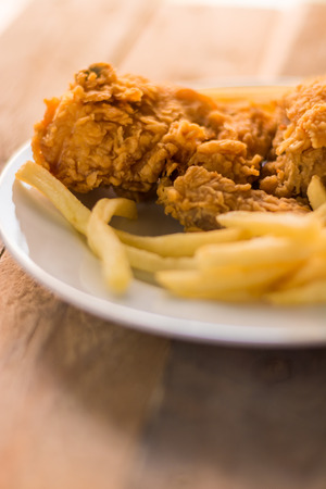 French fries and fried chicken Archivio Fotografico