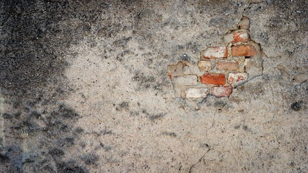 damping: Old and dirty brick wall with damping plaster Stock Photo