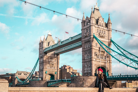 london tower bridge: Photo of Girl in front of London Tower Bridge Stock Photo