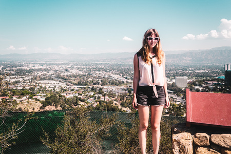 north hollywood: Photo of Girl at Hollywood Hills with panoramic view of Los Angeles