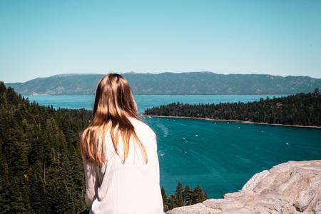 south lake tahoe: Photo of Girl looking at Emerald Bay and Lake Tahoe