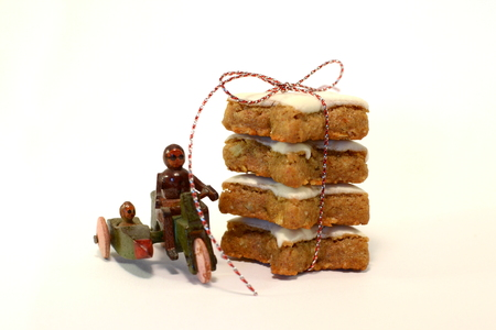 Cinnamon cookie with old wooden toy in christmas time