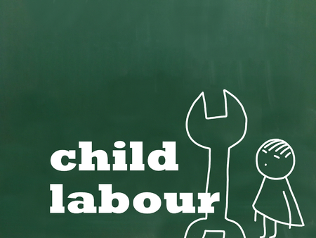 An illustration about child labour and the lettering child labour on a green chalkboard.