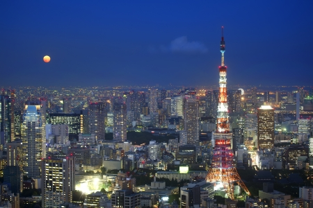 moon  metropolis: Tokyo Tower at Night with Full Moon Stock Photo
