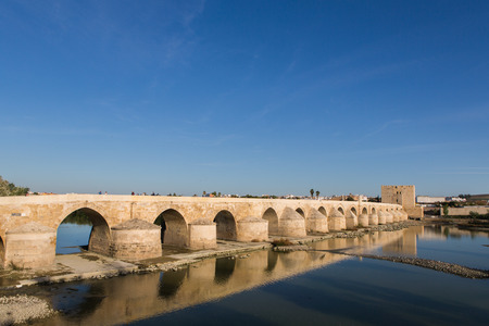 1st century: The Roman bridge across the Guadalquivir river, built in the early 1st century BC in the Historic center of Cordoba, Andalusia, South of Spain Stock Photo