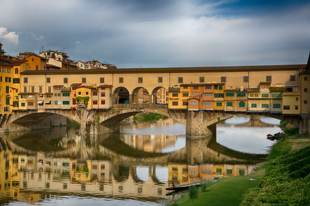Ponte Vecchio bridge over the river Arno. Bridge is one of the biggest tourist attractions in Florence. Italy