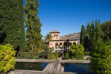 Ladies Tower (Torre de las Damas) and Gardens of the Partal. This moorish building was built in the middle ages in fortress complex Alhambra in Granada. Spain