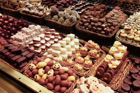 A large variety of sweets and cakes on confectionary display. Reklamní fotografie