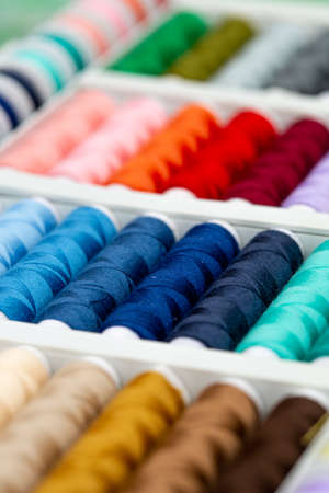 A set of threads in different colors. Multicolored threads for sewing and needlework. Small rolls of thread in a different colours.