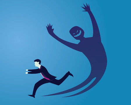 Businessman running away afraid of his own inner evil monster shadow