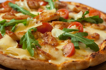 A delicious freshly baked Italian-style pizza on a wooden board in daylight photographed. Stock Photo - 8591274