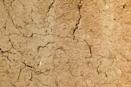 mud wall: Close up shot of an adobe mud wall with lots of cracks. Stock Photo