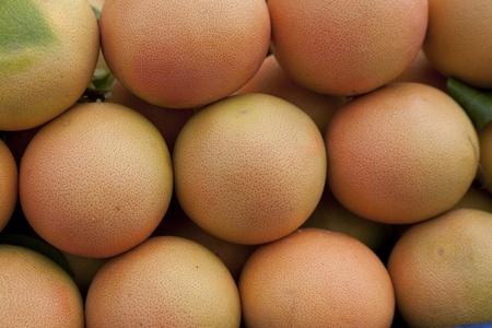 Macro shot of grapefruits at the market. Natural light. Stock Photo - 10886186