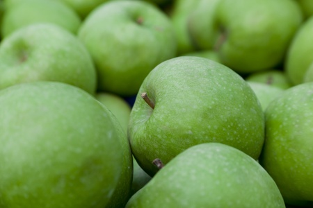 Close-up shot of green juicy apples. Shallow depth of field.