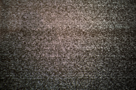 Analogue television static. This is a color image, at 100 % the red, green and blue cells are clear.