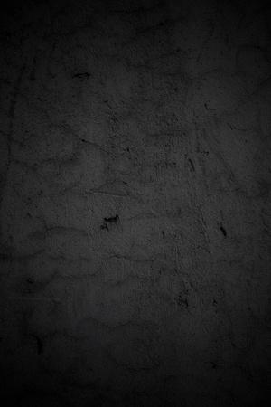 Grungy dark wall background. Vignette added.