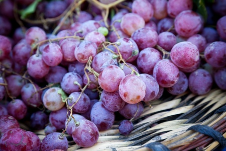 Close up shot of grapes on a basket in a local market. Natural light.
