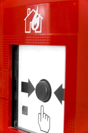glass break: Fire alarm button. Shallow depth of field. Focus is on button. Stock Photo