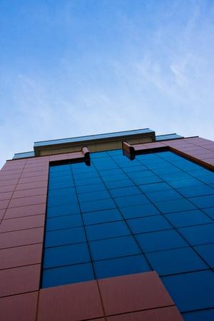 Modern office building under blue sky.