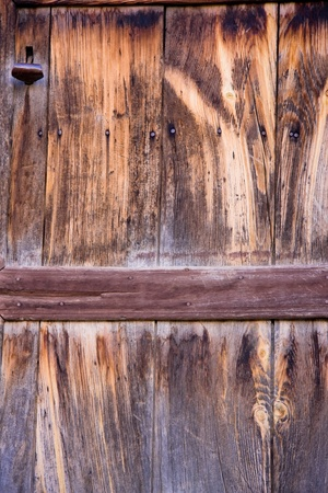 Very old wooden door with a rusted iron handle.