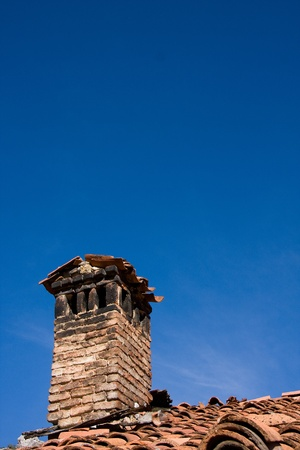 Old chimney and blue sky. photo