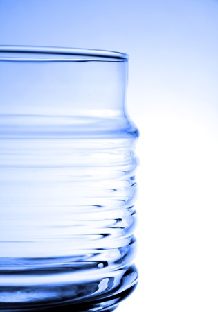 Half of a jar. Back lit, blue tone.